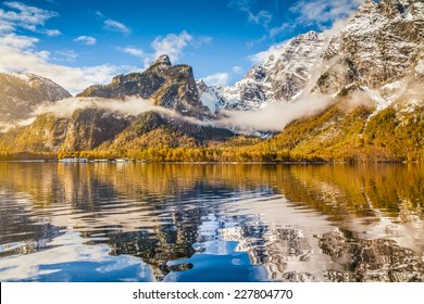 Idyllic autumn scene in the Alps with mountain lake reflection in beautiful morning light