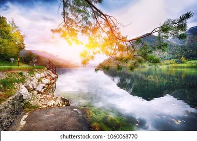 Idyllic autumn scene in Grundlsee lake. Location: resort Grundlsee, Liezen District of Styria, Austria, Alps. Europe.