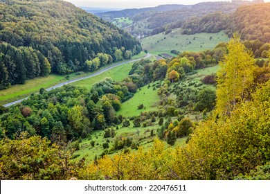 Idyllic Autumn Scenery near a lovely Country Road in the rocky Jura Mountains of Bavaria, Germany. Sunset in Fall with a wonderful sky in the rural countryside.