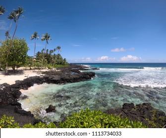 Idyllic beach with palm trees, sand and rocks at Lefaga, Matautu, Upolu Island, Western Samoa, South Pacific