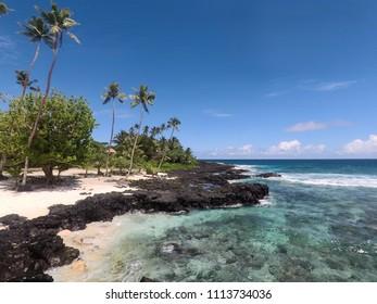 Idyllic beach with sand and rocks at Lefaga, Matautu, Upolu Island, Western Samoa, South Pacific