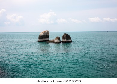 Idyllic blue sea and clear sky and stand-alone rocks. Taken in Koh Samui, Thailand