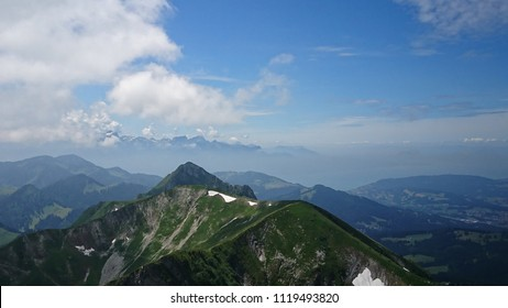 Idyllic cloudy Alpine scenery from Le Moléson Summit on a warm Summer day - Bernese Alps - Switzerland