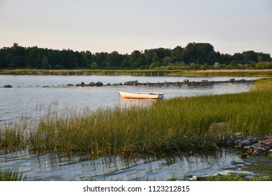 Idyllic coastal view with a small rowing boat anchored in a bay at the swedish island Oland in the Baltic Sea