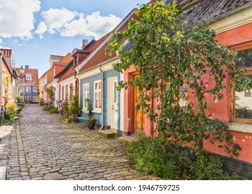 An idyllic cobbled street with colorful houses at the old town of Aalborg, Denmark - Shutterstock ID 1946759725