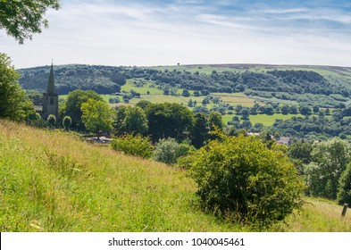Idyllic countryside in summer in the Hope Valley near Hathersage, Peak District, Derbyshire, England. Church in the background is St Michael & All Angels - where Little John of Robin Good is buried.