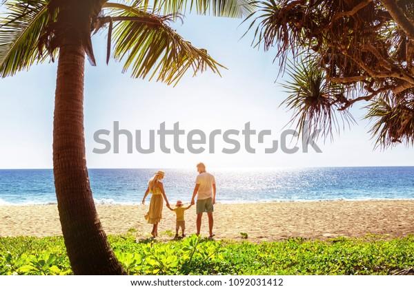 Idyllic family at beautiful tropical sea beach. Phuket island, Thailand
