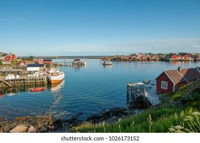 Idyllic fishing village Reine on a summer evening at Lofoten islands in northern Norway. Lofoten is a popular tourist destination.