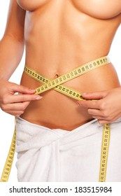 Idyllic form. Cropped image of beautiful young shirtless woman measuring her hip while standing isolated on white