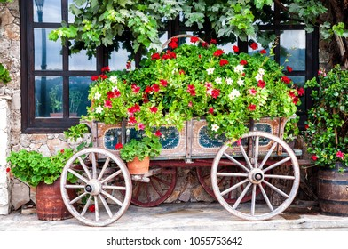 Idyllic garden with old wooden cart