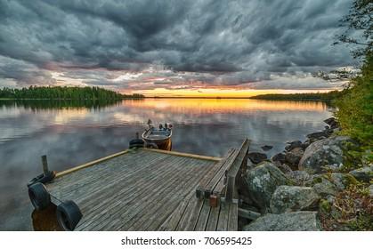 Idyllic lake sunset with fishing boat