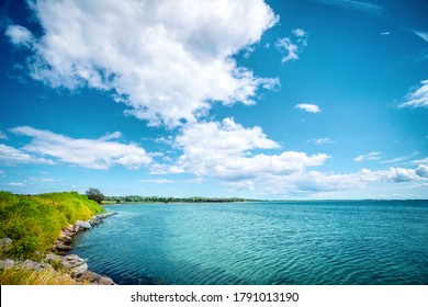 Idyllic lake with turquoise water in the summer with rocks by the lakeside under a blue sky - Shutterstock ID 1791013190
