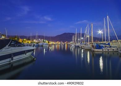 Idyllic landscape with beautiful reflections in Kalamata's Marina at sunset. Kalamata city, Messenia, Peloponnese, Greece