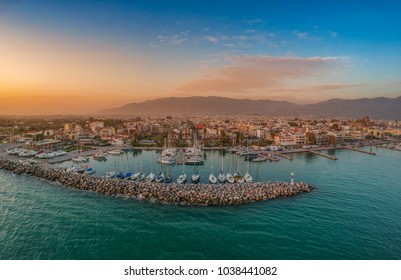 Idyllic landscape flying above Kalamata's Marina at sunset. Aerial photography of Kalamata city, Messenia, Peloponnese, Greece
