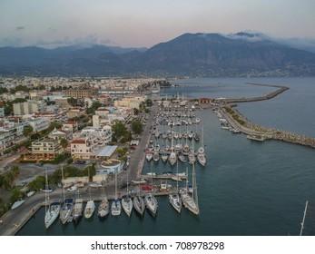 Idyllic landscape flying above Kalamata's Marina at sunset. Aerial photography of Kalamata city, Messenia, Peloponnese, Greece