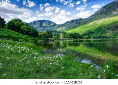 Idyllic landscape of Lake District National Park, Cumbria, Uk.UNESCO world heritage side.Beautiful scenery of mountain valley with  clean lake in spring.Blue sky with few clouds over green hills.