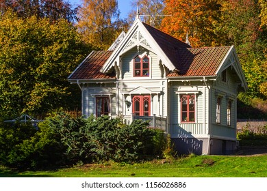 Idyllic little cottage with autumn colors on the trees