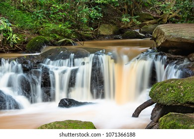 Idyllic long exposure detail shot of a small Nairobi River waterfall in Karura Forest, Kenya.