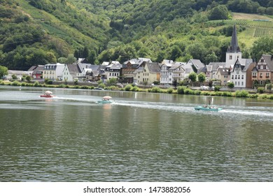idyllic Moselle valley village Brieden with cars taking a swim