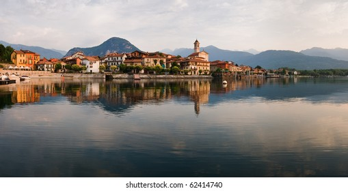 Idyllic panorama of Maggiore Lake with water reflections in Italy