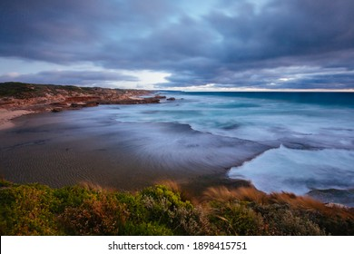 The idyllic Pearses Beach and headland around Pirates Bay Cove on a hot summer's evening near Blairgowrie, Victoria, Australia