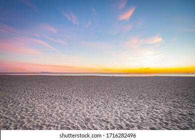 Idyllic perfect tropical white sandy beach and colorful sunset as  summer vacation natural background with blue sky