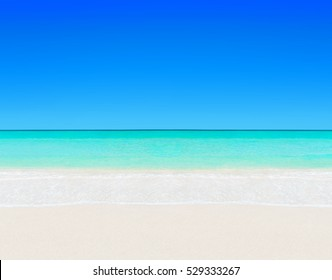 Idyllic perfect tropical white sandy beach and turquoise clear ocean water - summer vacation natural background with blue sunny sky