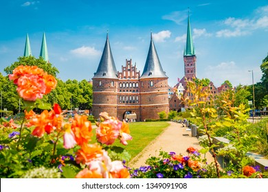 Idyllic postcard view of the historic town of Lübeck with famous Holstentor town gate on a beautiful sunny day with blue sky and clouds in summer, Schleswig-Holstein, northern Germany