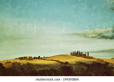 Idyllic rural Tuscan landscape with old farmhouse near Pienza at sunset, Vall d'Orcia Italy, Europe. Filtered. Vintage effect applied