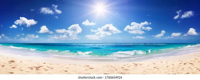 Idyllic Sand Beach With Sun Over Ocean
