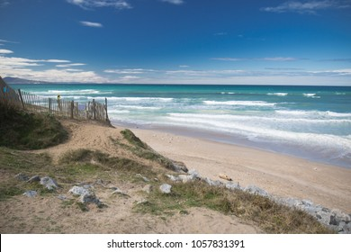 idyllic sandy beach in sunny blue sky by atlantic ocean in bidart, basque country, france