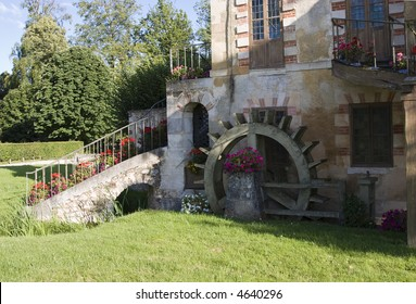 Idyllic scene of a country house with water wheel