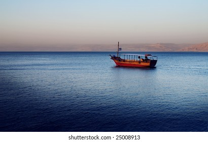 Idyllic scene with a small boat on the Sea of Galilee