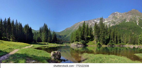 Idyllic scenery in the Austrian alps at a little lake in the mountains.
