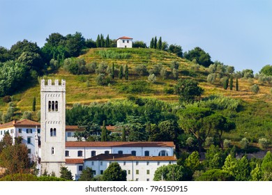 Idyllic and scenic landscape - Bell tower, church, field, forest and hill - Tuscany, Italy; tourism, travel, vacation; background.