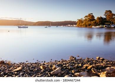 The idyllic setting across Wagonga Inlet at sunset in Narooma, NSW, Australia