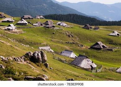 Idyllic herdsmen's settlement of wooden houses on Velika Planina / Big Pasture Plateau mountain plateau in the Kamnik–Savinja Alps northeast of Kamnik, Slovenia
