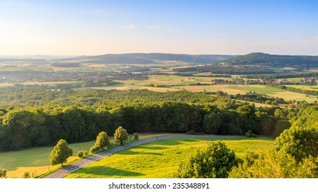 Idyllic Spring countryside Landscape. Farmland, Villages, Hills and Meadows