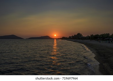 Idyllic sunstet view of the famous Yalova beach located at Yalova village in Messenia, Peloponnese, Greece.