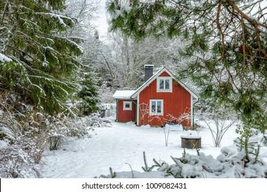Idyllic Swedish house in winter scenery