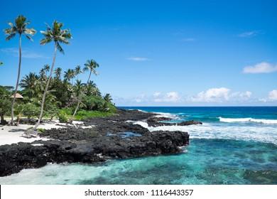 Idyllic tropical beach with blue sea and sky at Lefaga, Matautu, Upolu Island, Western Samoa, South Pacific