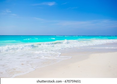 Idyllic tropical beach on Cuba in Caribs with white sand, turquoise ocean water and blue sky