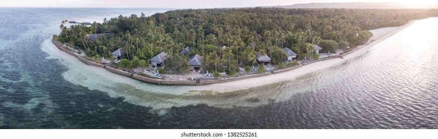 An idyllic tropical resort is found on a remote island in the Wakatobi National Park, Indonesia. This region is known for its incredible coral reefs and high marine biodiversity.