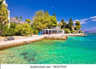 Idyllic turquoise beach in Kastela bay view, Dalmatia region of Croatia