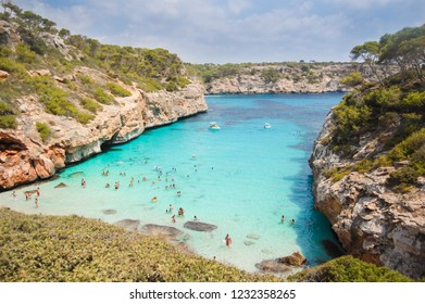 Idyllic turquoise crystal clear beach bay Caló des Moro in Mallorca, Spain.