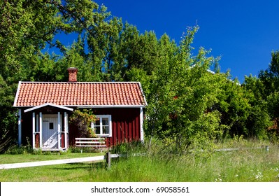 Idyllic, typical swedish cottage in summer time.