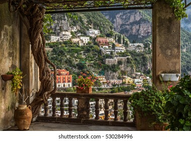 """Idyllic view of the historic and famous coast village """"Positano"""" with its church near Naples in South Italy"""