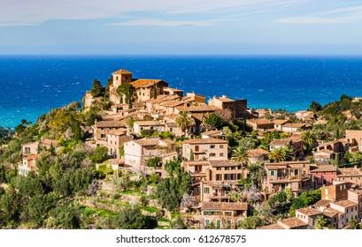 Idyllic view of the mediterranean mountain village Deia on Majorca, Spain Balearic Islands.