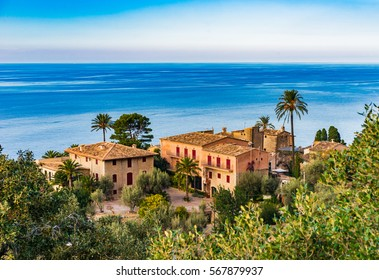 Idyllic view of old rustic mediterranean houses with sea view at the coastline of Majorca Spain.