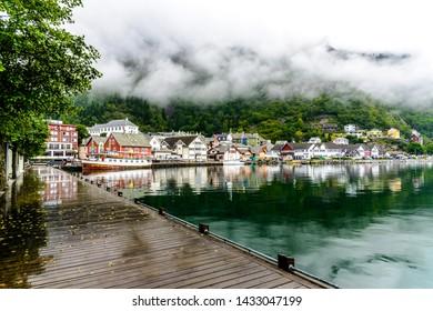 Idyllic view on cloudy fjord Sorfjorden, harbor port marina in Odda, beginning of the way to Trolltunga. Norway